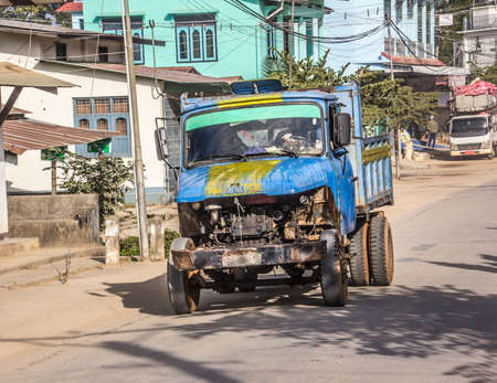 streetscene: Typical Myanmar streetscene with an old chinese truck
