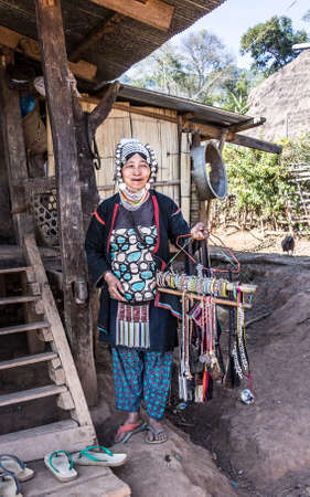 Woman of the Akha tribe in the hills near keng Tung is selling her goods