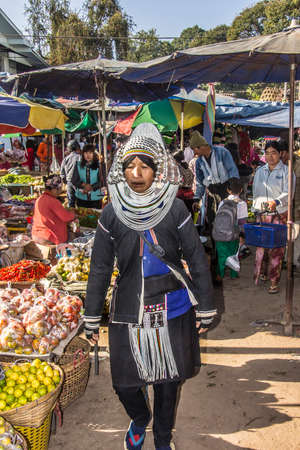 Akha woman in traditional costume on the market of Keng Tung Myanmar