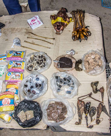 shamanic: shamanic medicine including a tiger paw and skull on the market of Keng Tung Myanmar