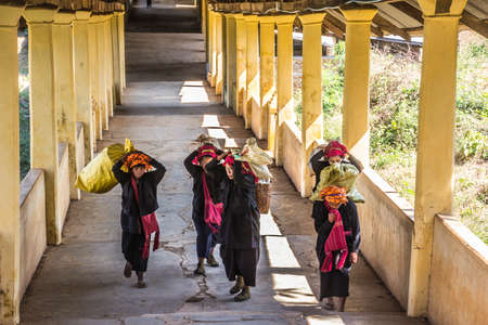 pao: PaO women with their goods are walking home from the market  at the Inle lake. Editorial