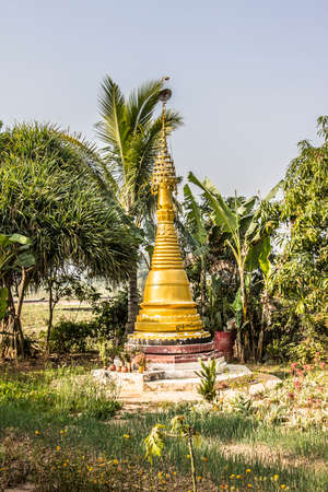 asian house plants: A golden paya, (or pagoda) in a garden at the side of the famous lake Inle, Myanmar Editorial