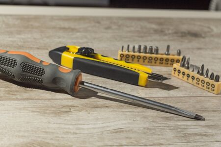 tools, screwdriver ,knife Wallpaper and attachments for drills are on the table