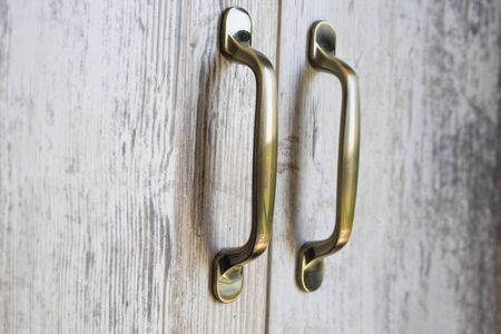 metal furniture handles on wooden doors
