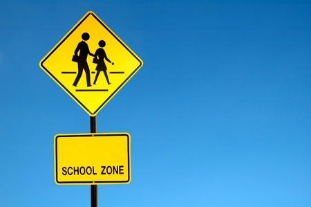school sign with blue sky photo