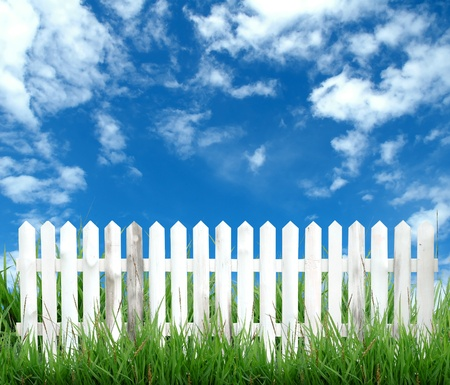 white picket fence: white fence with blue sky