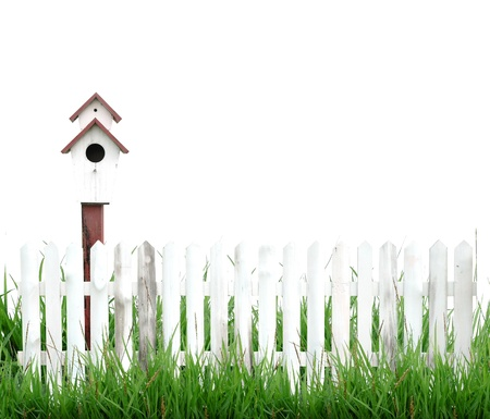 picket fence: birdhouse with green grass isolated