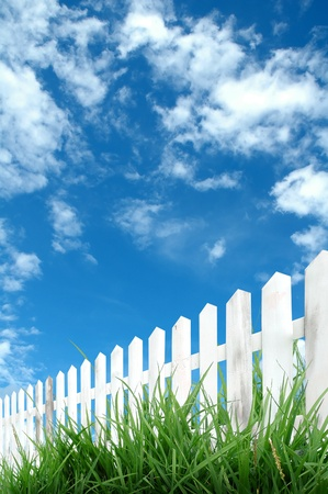 picket fence: white fence with blue sky