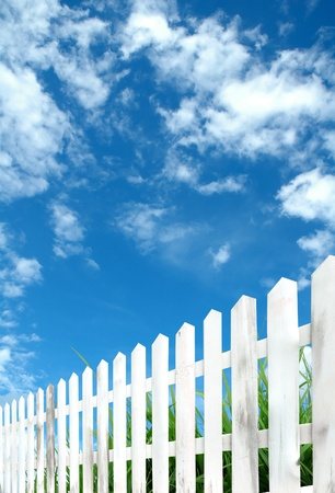 white fence with blue sky photo