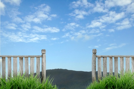 wooden fence with green grass and blue sky Stock Photo - 8429072