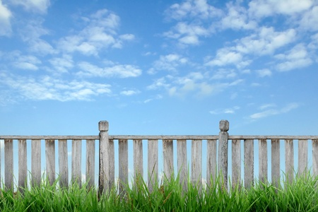 wooden fence with green grass and blue sky Stock Photo - 8429078