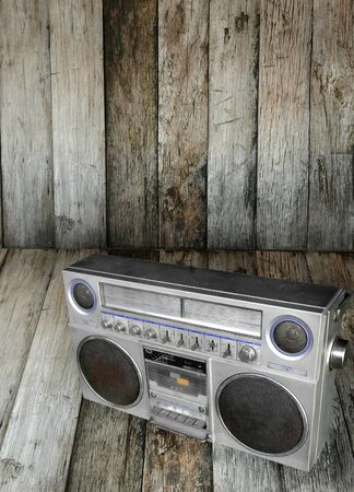 old radio on wooden floor photo