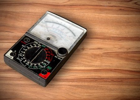volt meter on wooden table Stock Photo - 8883785