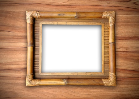 bamboo frame on wooden wall Stock Photo - 8883758