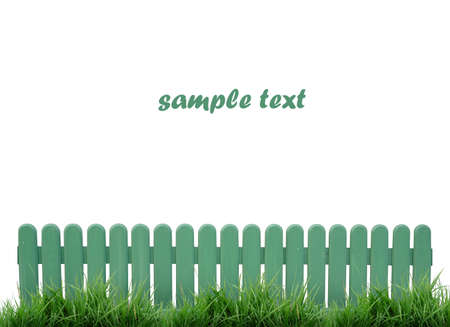 white fence: green fence and green grass isolated