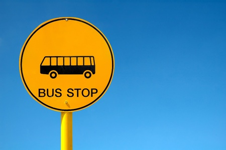 bus stop sign and blue sky photo
