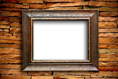 old picture: wooden frame on brick wall