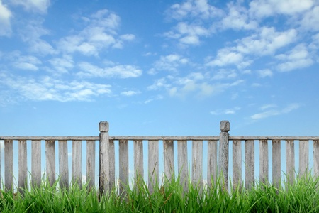 wooden fence with green grass and blue sky Stock Photo - 9002612