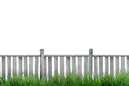 picket fence: wooden fence with green grass isolated