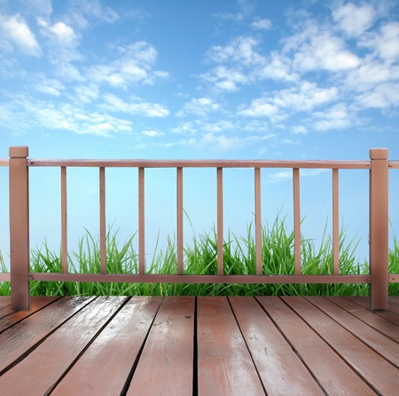 balcony view: wooden terrace and blue sky