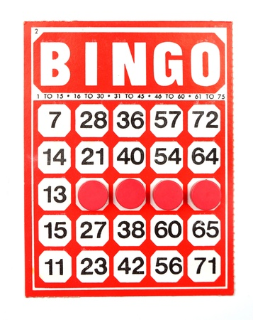 Red bingo card with winning chips  photo