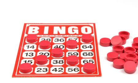 Red bingo card with winning chips  photo
