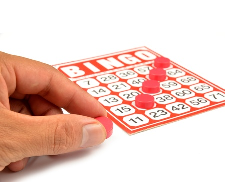 bingo card with hand hold winning chips Stock Photo - 9639637