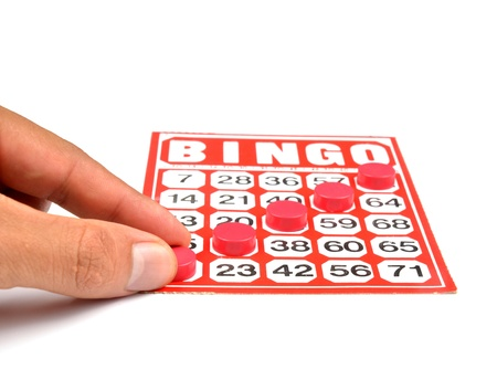 bingo card with hand hold winning chips  photo