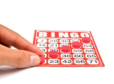 bingo card with hand hold winning chips  photo