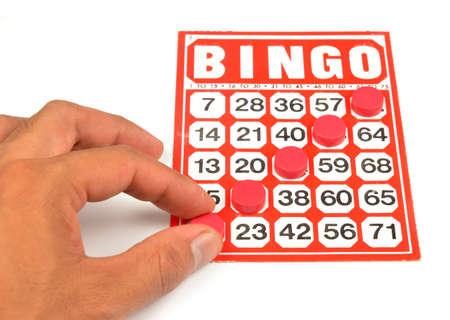 bingo card with hand hold winning chips Stock Photo - 9639638