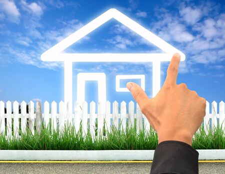 hand drawing a imagine house icon Stock Photo - 9681229
