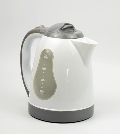 plastic kettle on white background photo
