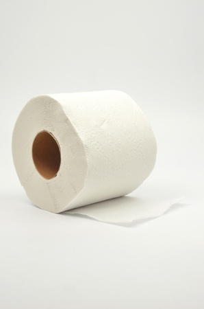 Simple toilet paper on gray background photo