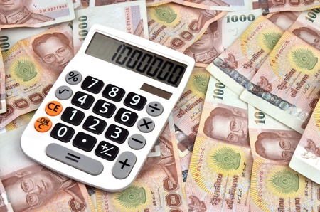 close up of 1000 baht banknotes and calculator  photo