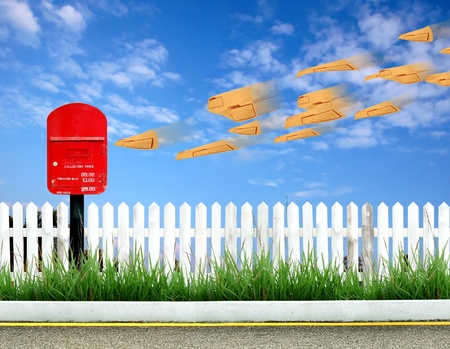 red postbox and brown envelope Stock Photo - 10051569