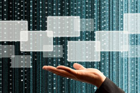 hand hold a touch screen interface with digital matrix background Stock Photo - 10051591