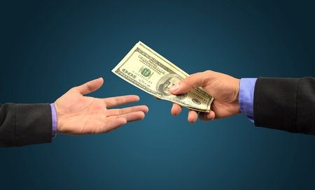 business man holding money in hand  Stock Photo - 10083002