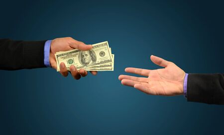 business man holding money in hand  photo