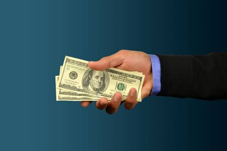business man holding money in hand  Stock Photo - 10082998