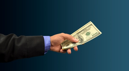 business man holding money in hand Stock Photo - 10083000