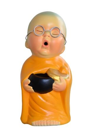 Earthenware of child monk isolated on white background  Stock Photo