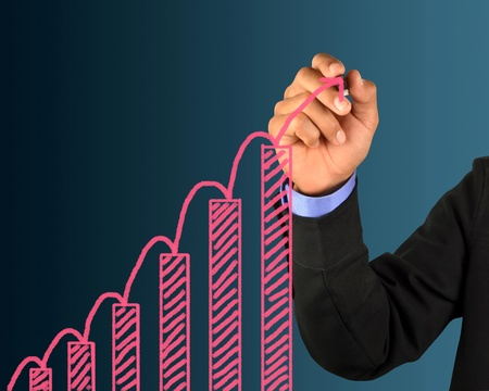 Male hand drawing a chart Stock Photo - 10203183