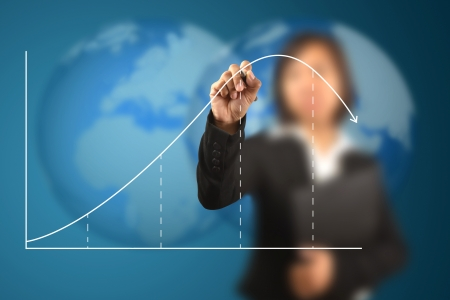 asian business: working women write business life cycle graph Stock Photo