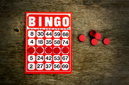 Red bingo card with winning chips Stock Photo - 10481653