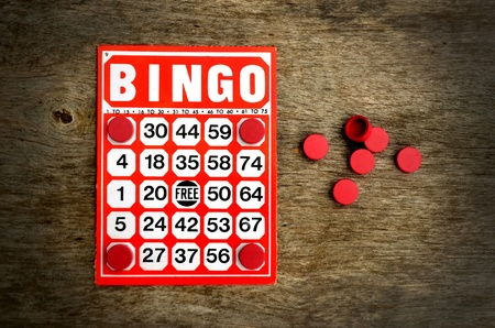 Red bingo card with winning chips  Stock Photo - 10481651