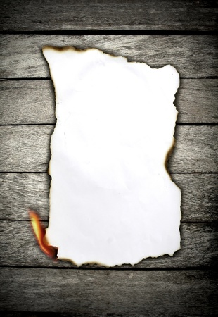Burning paper on wooden wall  photo