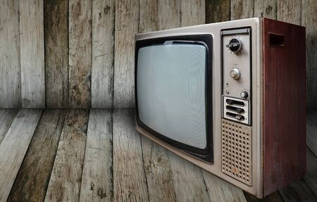 old television: old television in wooden room