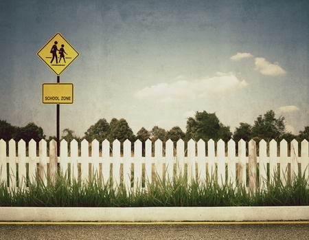 old fence: vintage picture of school zone sign Stock Photo