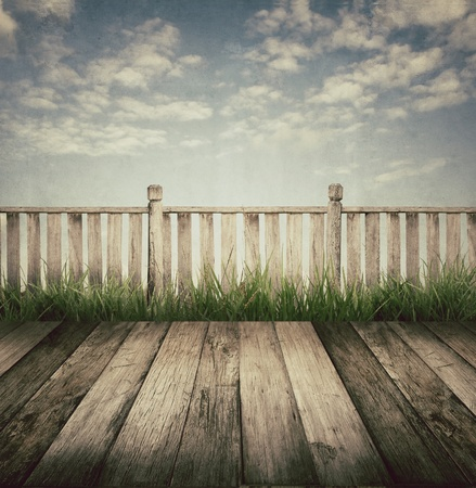 old fence: old wooden terrace and blue sky, vintage style  Stock Photo