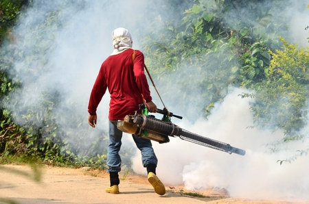 malaria: man Fogging to prevent spread of dengue fever in thailand Editorial
